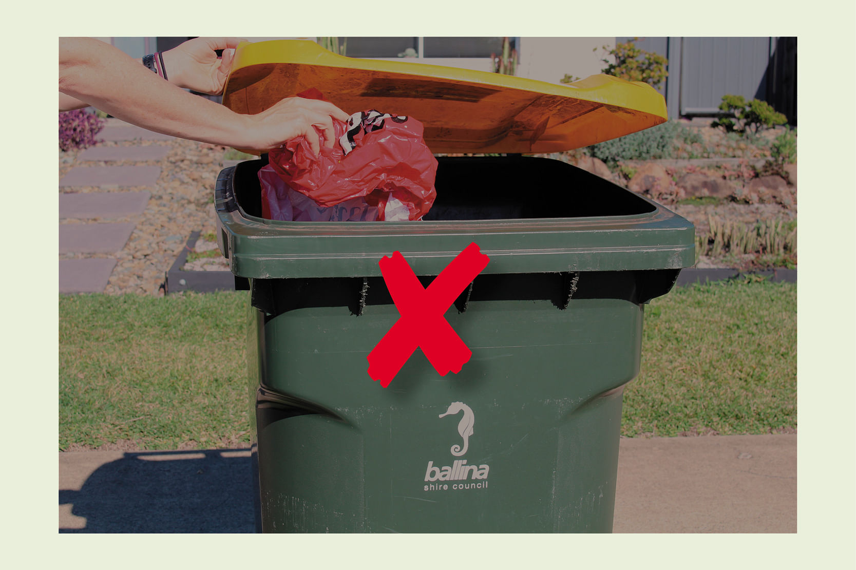 Image of soft plastic being placed in yellow bin